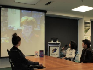 Rural youth chatting with Hazel Edwards on video screen.